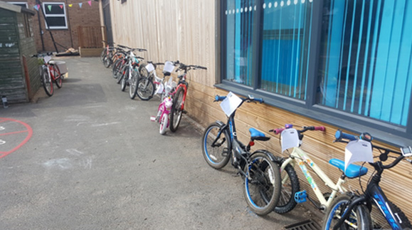 cycling at school - childrens bikes ready for maintenance